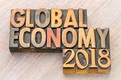 global economy 2018  word abstract in vintage letterpress wood type poster