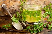 stock photo of hyssop  - herbal healing tea from Brahmi on a wooden background - JPG