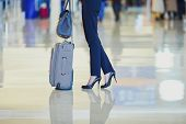 Business Woman With Hand Luggage In An Airport poster