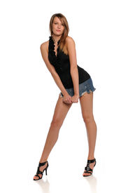 image of mini-skirt  - Young Brunette Woman wearing a mini skirt  isolated on a white background - JPG