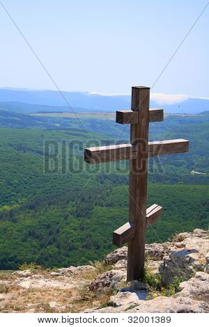 Christian cross on top of a mountain