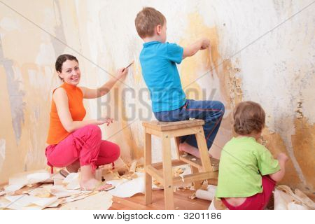 Children Help Mother Remove Old Wallpapers