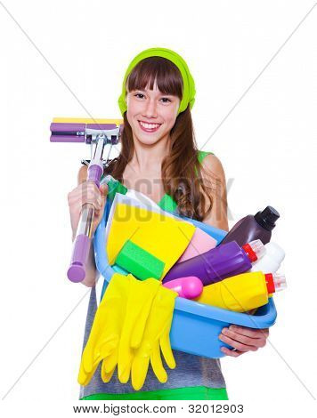 Cheerful teen holding detergents and mop