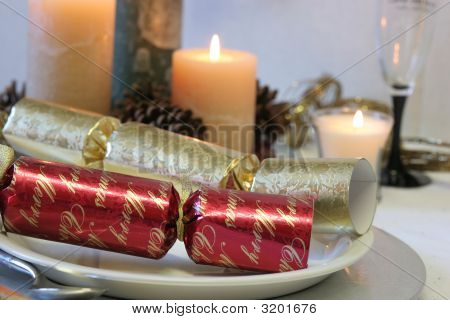 Red And Gold Christmas Crackers With Candles