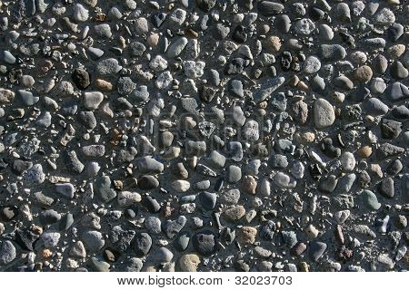 Aggregate Rock Imbeded in Concrete