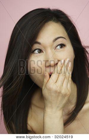 Asian woman looking surprised