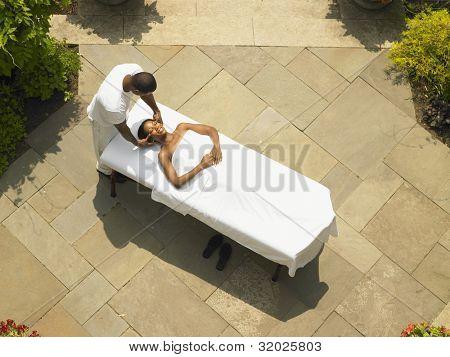 Young woman having a scalp massage