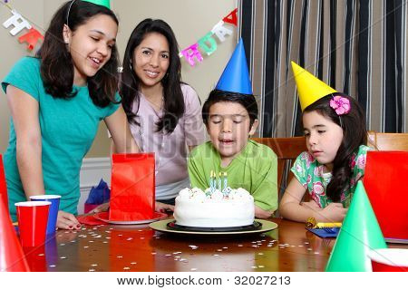 Group enjoying a birthday party for child