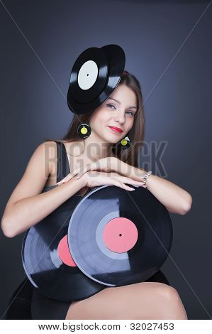 Emotional Girl In Black Dress With Vinyl Record