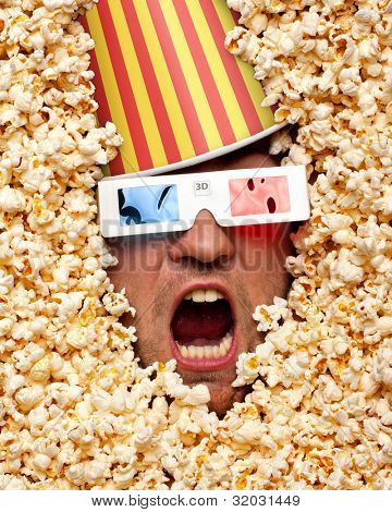 Surprised face in popcorn with bucket on head watching 3D movie