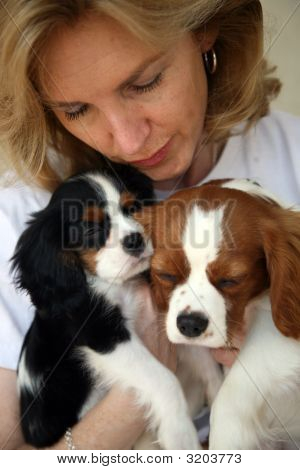 Woman Holding Sleepy Puppies