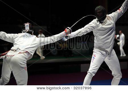 KIEV, UKRAINE - APRIL 14, 2012: Fight between Fabian Kauter, Switzerland and Weston Kelsey, USA during World Fencing Championship on April 14, 2012 in Kiev, Ukraine