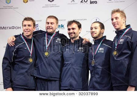KIEV, UKRAINE - APRIL 14, 2012: USA men's epee team on medal ceremony during World Fencing Championship on April 14, 2012 in Kiev, Ukraine