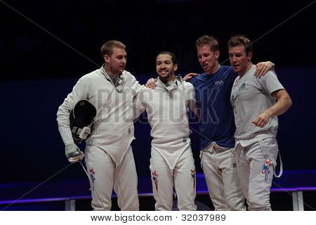 KIEV, UKRAINE - APRIL 14, 2012: USA team celebrate the victory in World Fencing Championship on April 14, 2012 in Kiev, Ukraine