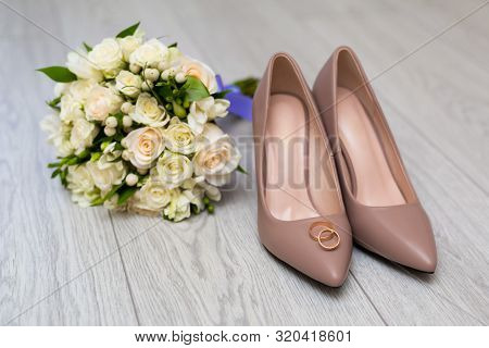 poster of Wedding Rings On The Brides Shoes. Wedding. Decor. Brides Shoes. Wedding Brides Shoes And Rings. Wed