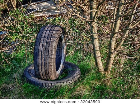 Abandoned Car Tires On Dump