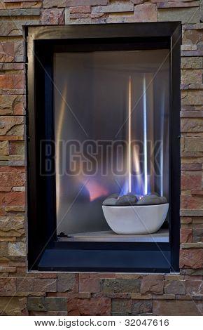 Gas Fireplace In Warm Flagstone Wall