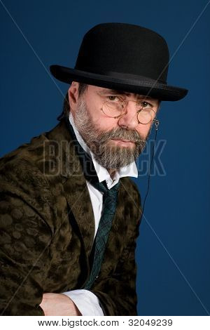 Middle aged man in vintage glasses pince nez