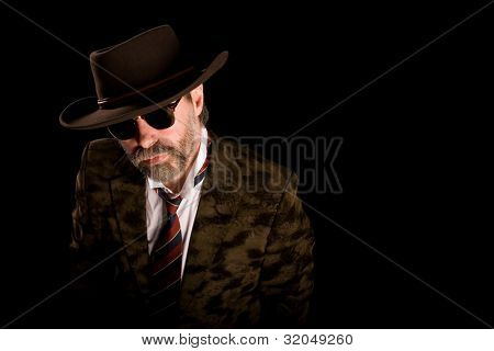 Portrait fashionable middle aged man in stetson