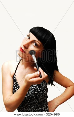 Young Woman Putting Make-Up On.