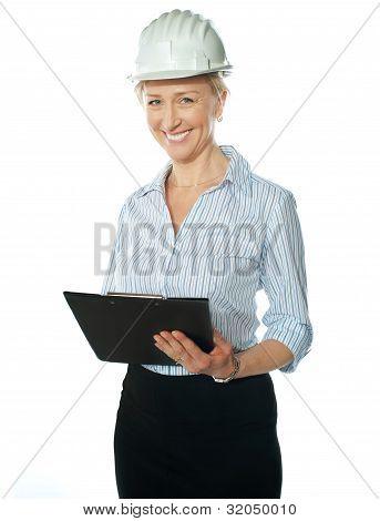 Smiling Female Architect Holding Documents