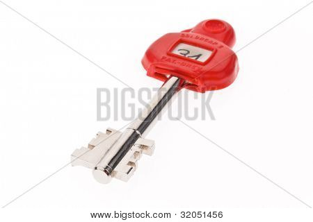 key to a safe isolated on white background.