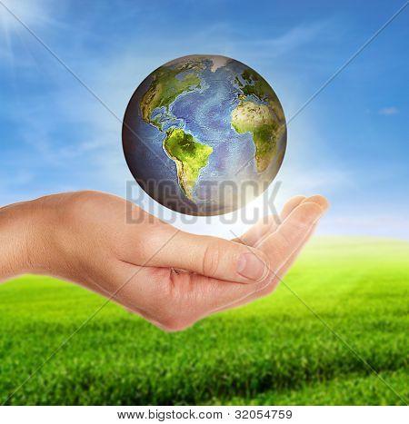 Female Hand Holding Globe