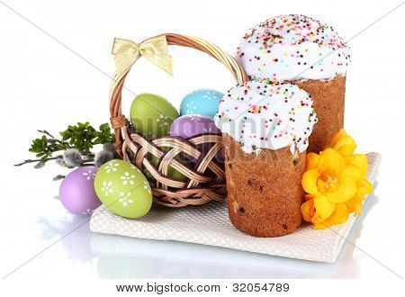 Beautiful Easter cakes, colorful eggs in basket and flowers isolated on white