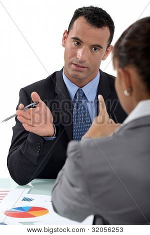 businessman and businesswoman having a discussion