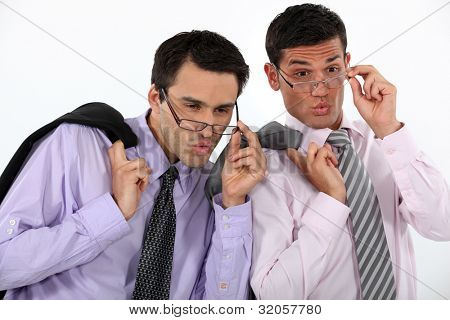 duo of young executives checking out girls in mini skirts