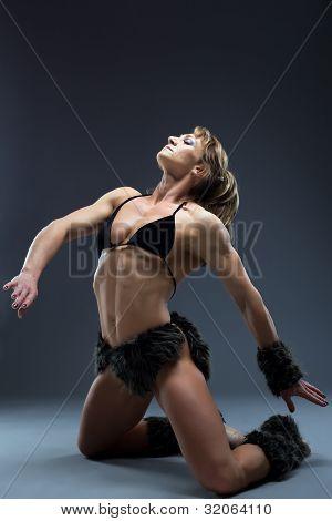 Aggressive woman posing in amazon fur costume