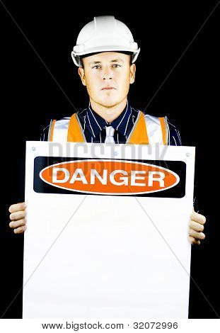 Man With Construction Helmet Holding Danger Sign