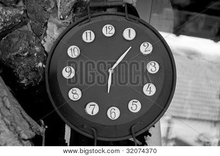 Clock from old pans in black and white