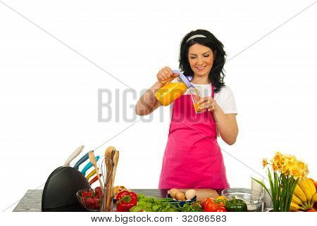 Happy Woman Pouring Orange Fresh