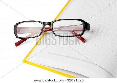 Yellow Book And Glasses