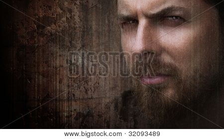 Artistic grungy portrait of cool man with nice eyes