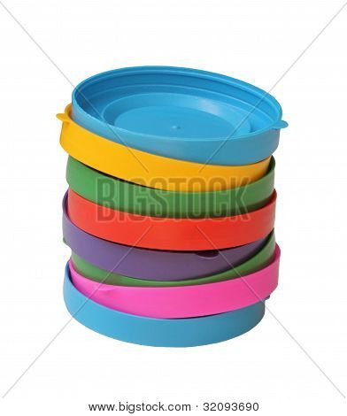 A Stack Of Colored Lids