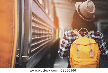 poster of Young Asian Woman Traveler With Backpack In The Railway, Backpack And Hat At The Train Station With