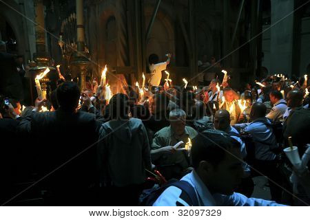 JERUSALEM - APRIL 18: Pilgrims come to Holy Sepulchre for Holy Fire (Holy Light) miracle ceremony on Holy Saturday Apr 18, 2009 in Jerusalem, Israel. About 10,000 worshipers attended the ceremony.