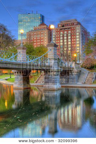 Lagoon Bridge and skyline of Boston, Massachusetts fromthe Boston Public Gardens.