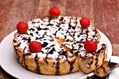 Cheesecake Decorated With Chocolate And Strawberries