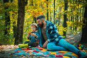 Hipster Bearded Dad With Cute Son Spend Time Together In Forest. Family Time. Family Leisure. Brutal poster