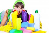 Portrait of teenage girl behind cleaning products