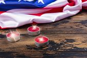 Usa Flag And Burning Candles On Wooden Background. Patriot Day, National Day Of Prayer And Remembran poster