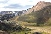 Tourists Go On A Mountain Route In Landmannalaugar. Iceland poster