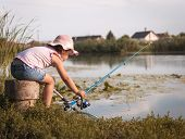 Sweet Little Girl On Fishing Near The River. Little Girl, 4-5 Years, Spending Fishing Time Alone On  poster