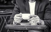 Cup Of Coffee. Cappuccino And Black Espresso Coffe Cup. Coffee Drink. Close Up Of A Man Hands Holdin poster