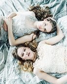 Two Pretty Twin Sister Blond Curly Hairstyle Girl In Luxury House Interior Together, Rich Young Peop poster