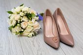 Wedding Rings On The Brides Shoes. Wedding. Decor. Brides Shoes. Wedding Brides Shoes And Rings. Wed poster