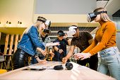 Business People Using Virtual Reality Goggles During Meeting. Team Of Multiethnical Developers Testi poster